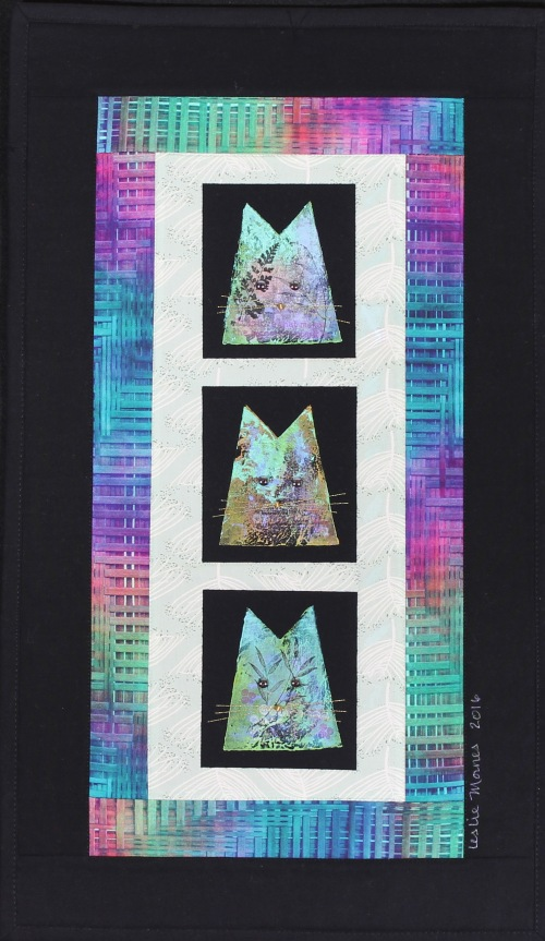 Cats turquoise purple and  mauve